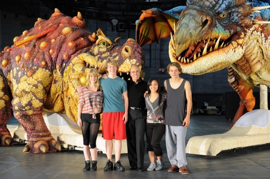 The principal cast and Jeffrey Katzenberg from the How to Train Your Dragon Arena Spectacular pose with the Gronckle and Deadly Nadder dragons