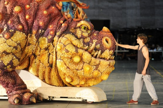 Rarmian Newton who plays Hiccup approaches the Gronckle dragon from the How to Train Your Dragon Arena Spectacular