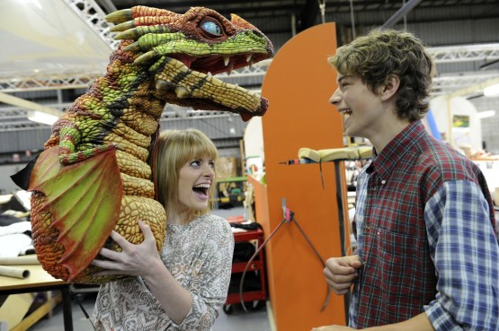 Rarmian Newton (Hiccup) and Sarah McCreanor (Astrid) pose with an Egg Biter dragon from the How to Train Your Dragon Arena Spectacular