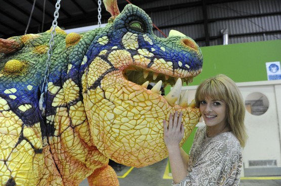 Sarah McCreanor (Astrid) pose with a Gronckle dragon from the How to Train Your Dragon Arena Spectacular